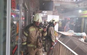 آتش سوزی هولناک در قلب تهران / دود در خیابان امیرکبیر همه را وحشت زده کرد + فیلم و عکس